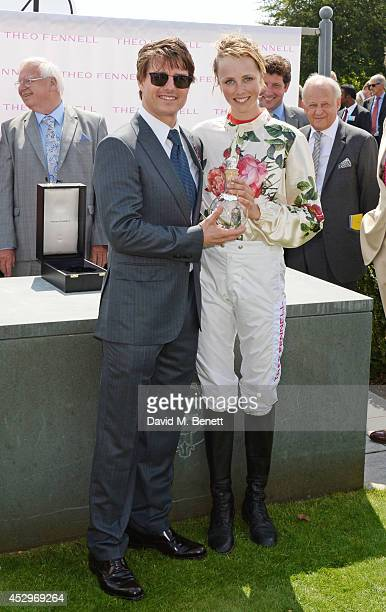 Tom Cruise presents Edie Campbell with her trophy after winning The Magnolia Cup at Glorious Goodwood Ladies Day at Goodwood on July 31 2014 in...