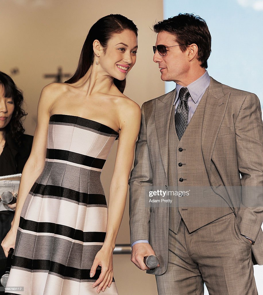 Tom Cruise shares a joke with Olga Kurylenko off the stage during the 'Oblivion' Japan Premiere at Roppongi Hills on May 8, 2013 in Tokyo, Japan. The film will open on May 31 in Japan.