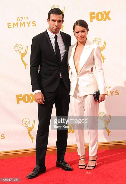 Tom Cullen and Actress Tatiana Maslany arrive at the 67th Annual Primetime Emmy Awards at the Microsoft Theater on September 20 2015 in Los Angeles...