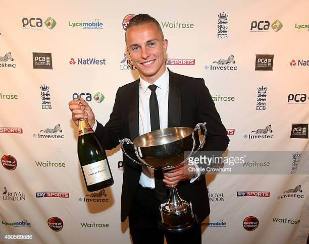 Tom Curran celebrates winning the John Arlott Cup for the PCA Young Player of the Year award during The PCA Awards at Tobacco Dock on September 29...
