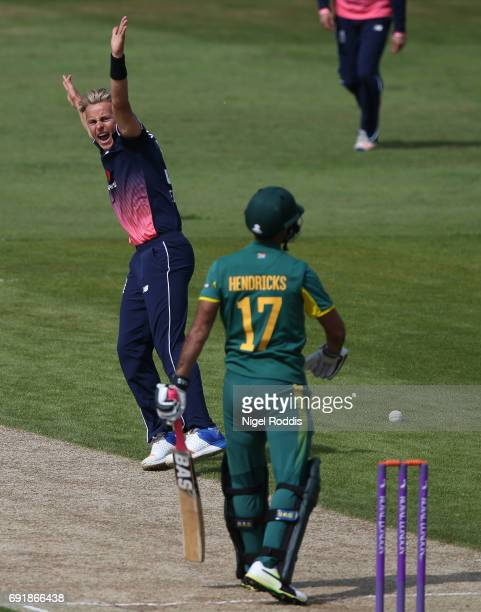 Tom Curran of England Lions celebrates taking the wicket of Reeza Hendricks of South Africa A during the One Day International match between England...