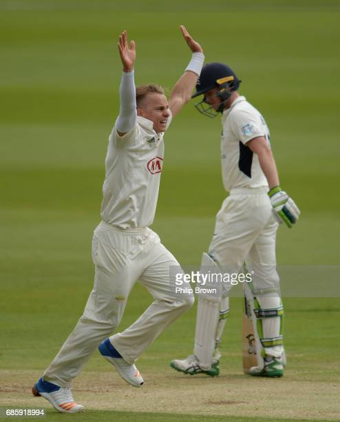 Tom Curran of Surrey appeals unsuccessfully for the wicket of Nick Gubbins during day two of the Specsavers County Championship Division One cricket...