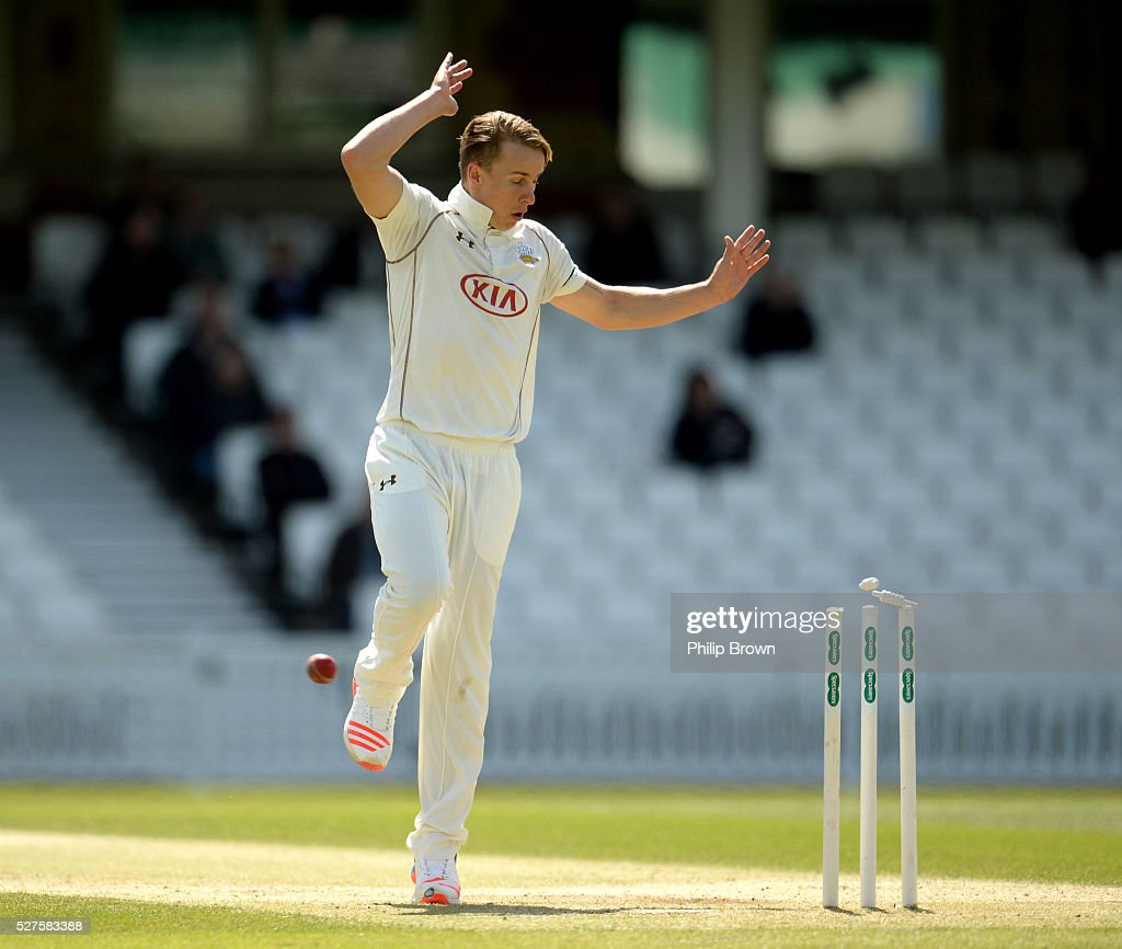 Tom Curran of Surrey avoids a throw during day three of the Specsavers County Championship Division One match between Surrey and Durham at the Kia Oval on May 3, 2016 in London, England.