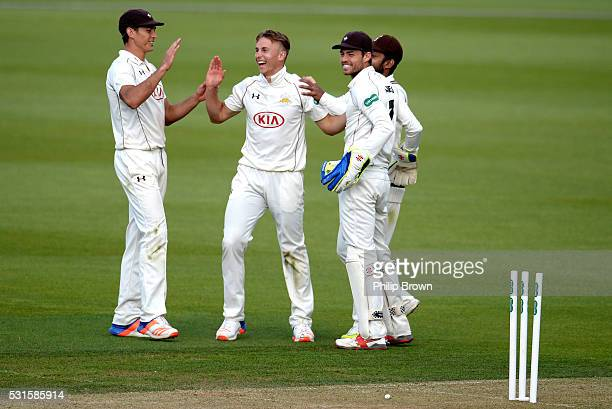 Tom Curran of Surrey celebrates after dismissing Paul Stirling of Middlesex during day one of the Specsavers County Championship Division One match...