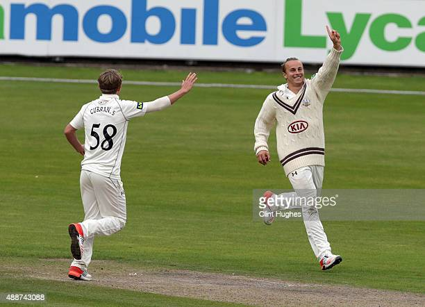 Tom Curran of Surrey celebrates after he takes a catch to dismiss Haseeb Hameed of Lancashire off the bowling of Sam Curran during day four of the LV...