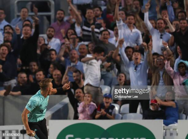 Tom Curran of Surrey celebrates catching out Sam Billings of Kent with the fans during the NatWest T20 Blast match between Surrey and Kent at The Kia...