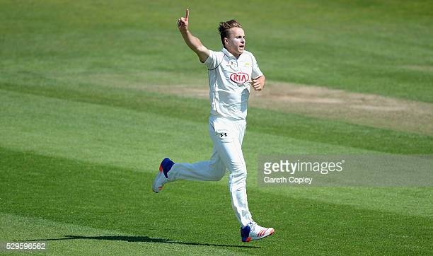 Tom Curran of Surrey celebrates dismissing Alex Lees of Yorkshire during day two of the Specsavers County Championship Division One match between...