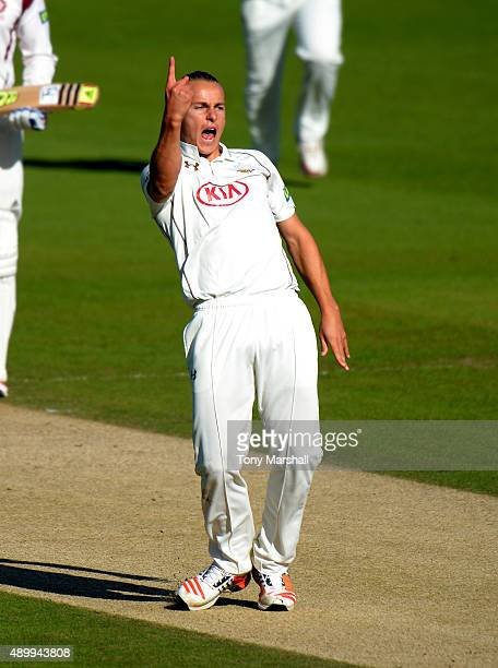 Tom Curran of Surrey celebrates dismissing Ben Duckett of Northamptonshire during the LV County Championship Division Two match between Surrey and...