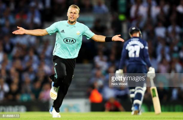 Tom Curran of Surrey celebrates taking the wicket of Ashar Zaidi during the Surrey v Essex NatWest T20 Blast cricket match at the Kia Oval on July 19...