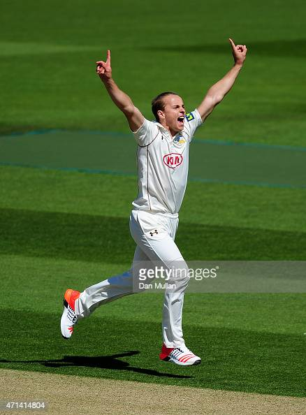 Tom Curran of Surrey celebrates taking the wicket of James Foster of Essex