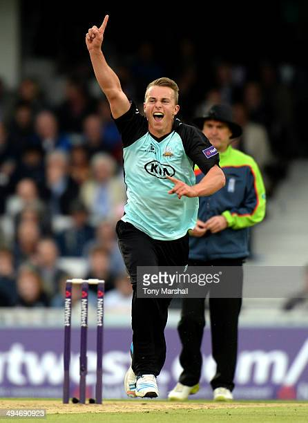 Tom Curran of Surrey celebrates taking the wicket of Joe Denly of Middlesex Panthers during the NatWest T20 Blast match between Surrey and Middlesex...