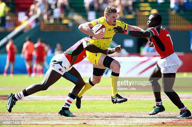 Tom Cusack of Australia in action against Kenya during day one of the Emirates Dubai Sevens HSBC Sevens World Series on December 5 2014 in Dubai...