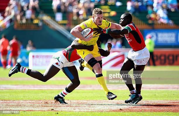 Tom Cusack of Australia in action against Kenya during day one of the Emirates Dubai Sevens HSBC Sevens World Series on December 5 2014 in Dubai...