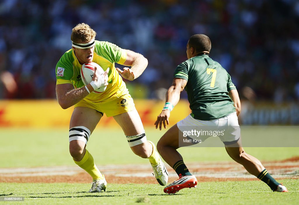 Tom Cusack of Australia takes on the defence during the 2016 Sydney Sevens Cup Semi Final match between Australia and South Africa at Allianz Stadium on February 7, 2016 in Sydney, Australia.