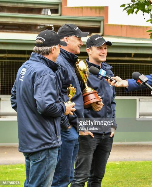 Tom Dabernig David Hayes and Ben Hayes after winning the Caulfield Cup at Caulfield Racecourse on October 22 2017 in Caulfield Australia