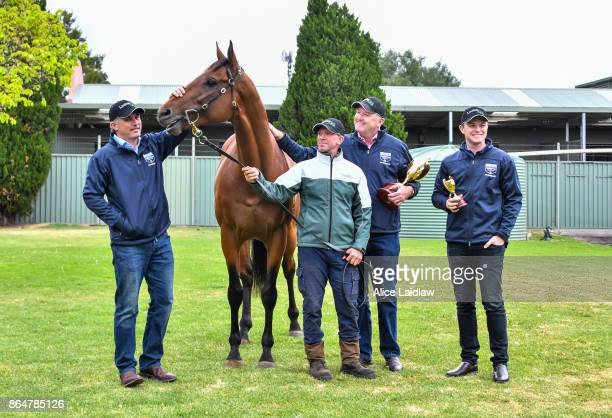 Tom Dabernig David Hayes and Ben Hayes with Boom Time after winning the Caulfield Cup at Caulfield Racecourse on October 22 2017 in Caulfield...
