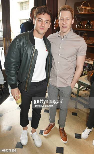 Tom Daley and Dustin Lance Black attend a breakfast hosted by Christopher Bailey Dame Natalie Massenet and Dylan Jones in celebration of London...