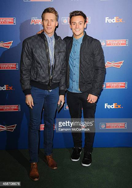 Tom Daley and Dustin Lance Black attend as the Dallas Cowboys play the Jacksonville Jaguars in an NFL match at Wembley Stadium on November 9 2014 in...