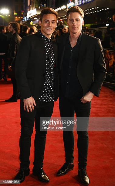 Tom Daley and Dustin Lance Black attend the UK Premiere of 'The Hunger Games Mockingjay Part 2' at Odeon Leicester Square on November 5 2015 in...