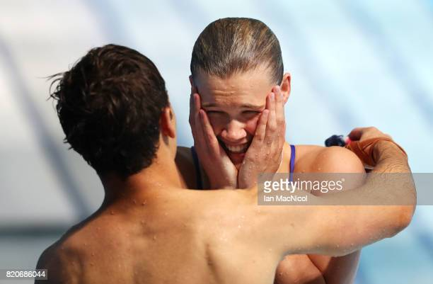 Tom Daley and Grace Reid of Great Britain react after winning silver in the Mixed 3m Synchro Springboard during day nine of the FINA World...