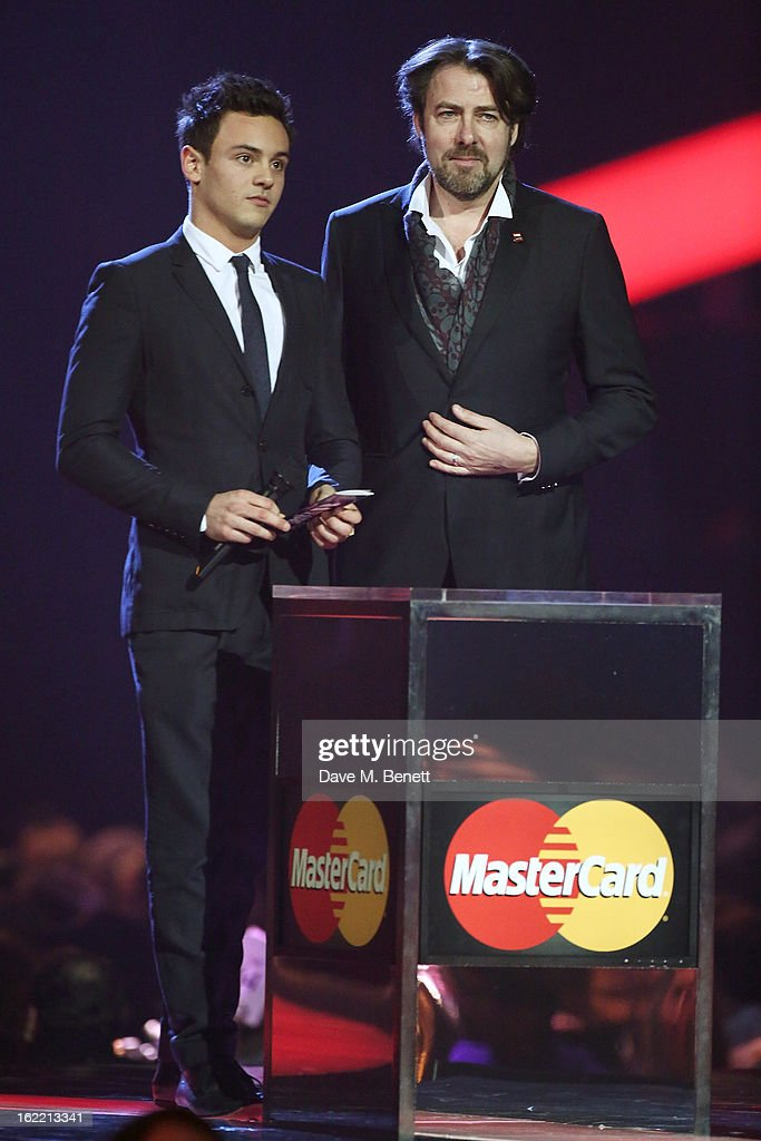 Tom Daley (L) and Jonathan Ross present on stage at the Brit Awards at 02 Arena on February 20, 2013 in London, England.