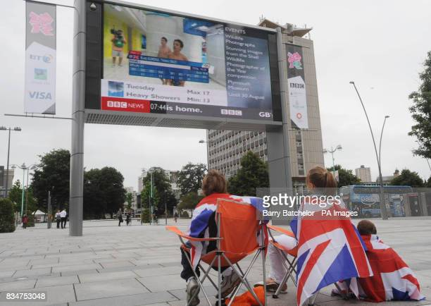 Tom Daley and partner Blake Aldridge after a dive during the Men's 10m Synchronized Final as viewed on the big screen erected in Plymouth city centre
