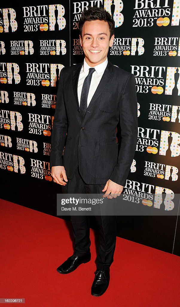 <a gi-track='captionPersonalityLinkClicked' href=/galleries/search?phrase=Tom+Daley&family=editorial&specificpeople=2652461 ng-click='$event.stopPropagation()'>Tom Daley</a> arrives at the BRIT Awards 2013 at the O2 Arena on February 20, 2013 in London, England.