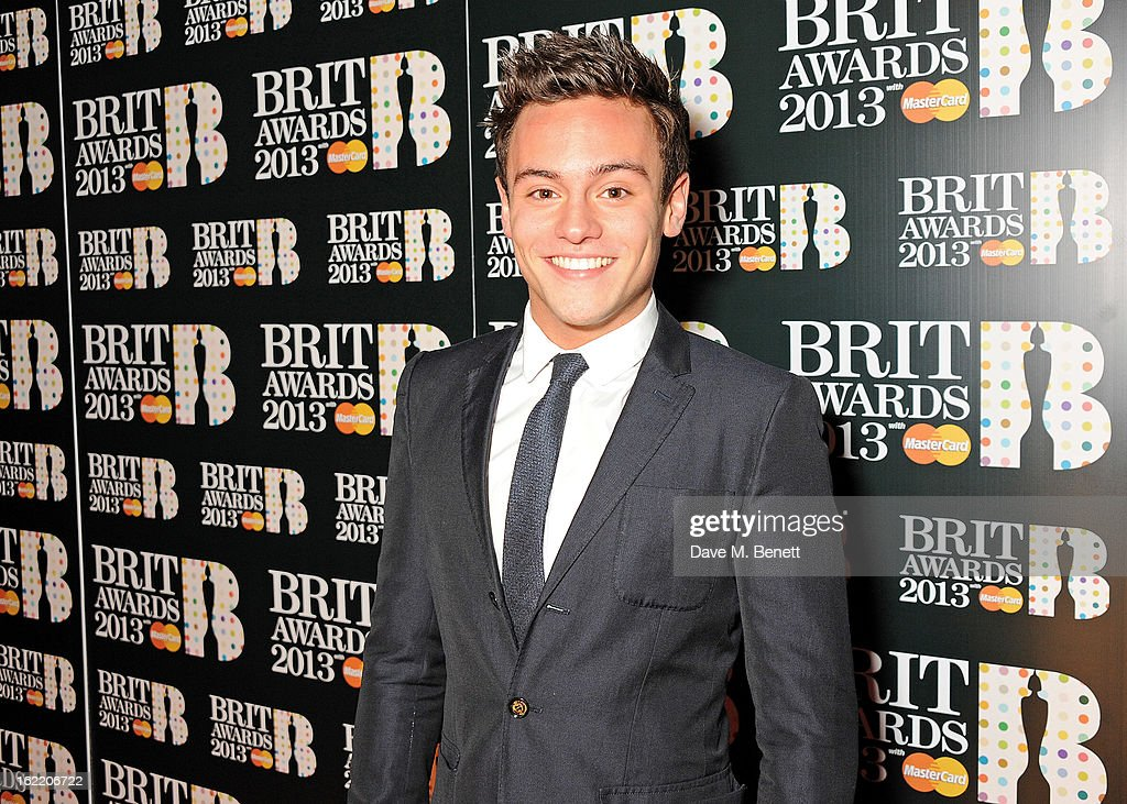<a gi-track='captionPersonalityLinkClicked' href=/galleries/search?phrase=Tom+Daley+-+Diver&family=editorial&specificpeople=2652461 ng-click='$event.stopPropagation()'>Tom Daley</a> arrives at the BRIT Awards 2013 at the O2 Arena on February 20, 2013 in London, England.