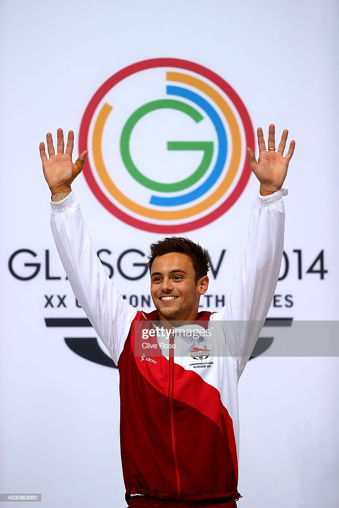 <a gi-track='captionPersonalityLinkClicked' href=/galleries/search?phrase=Tom+Daley+-+Diver&family=editorial&specificpeople=2652461 ng-click='$event.stopPropagation()'>Tom Daley</a> of England celebrates on the podium after winning the Gold medal in the Men's 10m Platform Final at the Royal Commonwealth Pool during day ten of the Glasgow 2014 Commonwealth Games on August 2, 2014 in Edinburgh, United Kingdom.