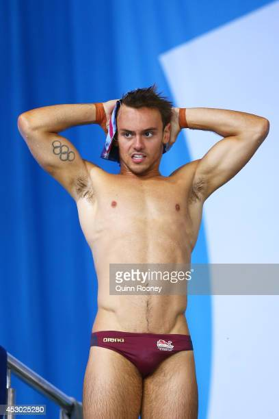 Tom Daley of England warms up prior to competing in the Men's Synchronised 10m Platform Final at Royal Commonwealth Pool during day nine of the...