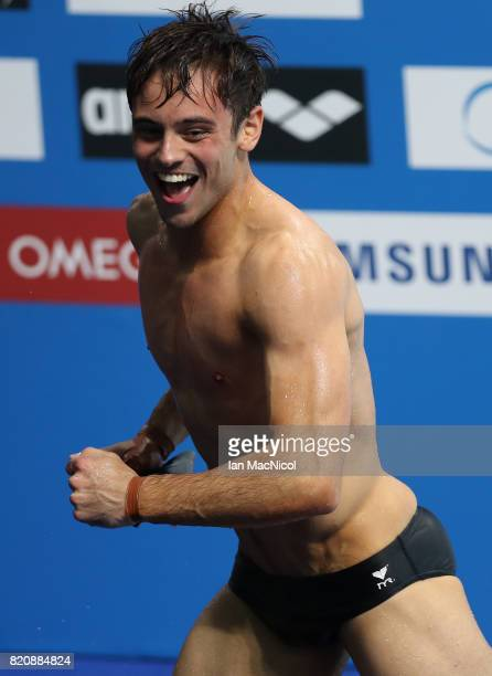 Tom Daley of Great Britain celebrates gold in the Men's 10m Platform during day nine of the FINA World Championships at the Duna Arena on July 22...