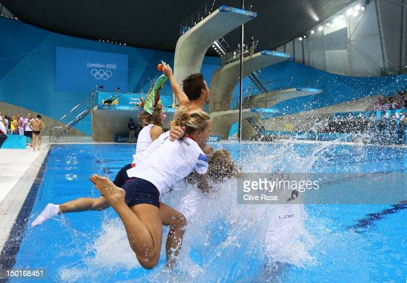 Tom Daley of Great Britain celebrates with his team mates after finishing third in the Men's 10m Platform Diving Final on Day 15 of the London 2012...