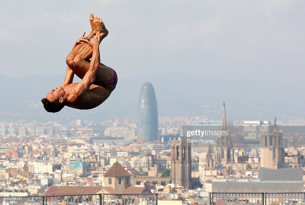 <a gi-track='captionPersonalityLinkClicked' href=/galleries/search?phrase=Tom+Daley&family=editorial&specificpeople=2652461 ng-click='$event.stopPropagation()'>Tom Daley</a> of Great Britain dives during a training session ahead of the World Championships on July 18, 2013 in Barcelona, Spain.