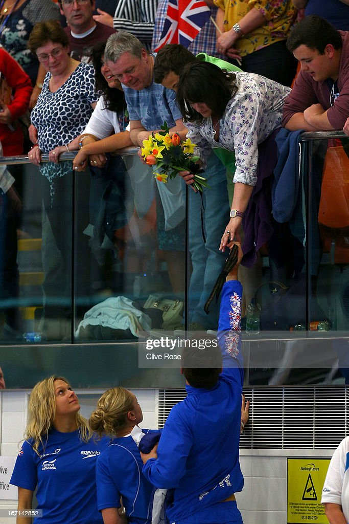 Tom Daley of Great Britain hands his medal to his mother Debbie after the Men's 10m Platform preliminary during day three of the FINA/Midea Diving World Series 2013 at the Royal Commonwealth Pool on April 21, 2013 in Edinburgh, Scotland.