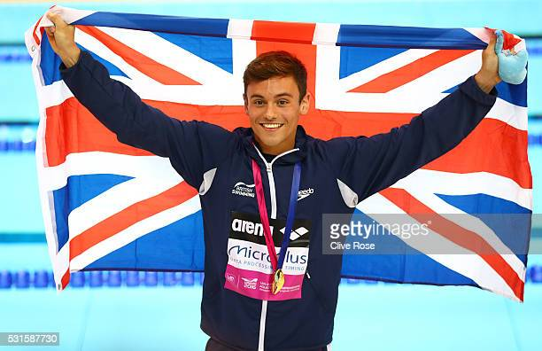 Tom Daley of Great Britain poses after receiving his gold medal for winning the Men's 10m Platform Final on day seven of the 33rd LEN European...