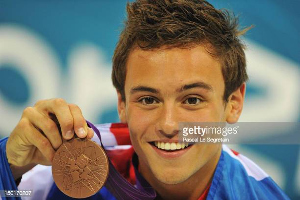 Tom Daley of Great Britain poses with his Bronze medal after the Men's 10m Platform Diving Final on Day 15 of the London 2012 Olympic Games at the...