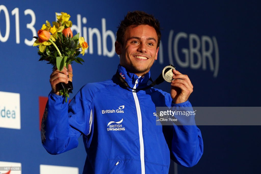 <a gi-track='captionPersonalityLinkClicked' href=/galleries/search?phrase=Tom+Daley+-+Diver&family=editorial&specificpeople=2652461 ng-click='$event.stopPropagation()'>Tom Daley</a> of Great Britain poses with his Gold medal on the podium after winning the Men's 10m Platform Final during day three of the FINA/Midea Diving World Series 2013 at the Royal Commonwealth Pool on April 21, 2013 in Edinburgh, Scotland.
