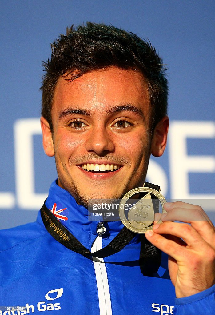 Tom Daley of Great Britain poses with his Gold medal on the podium after winning the Men's 10m Platform Final during day three of the FINA/Midea Diving World Series 2013 at the Royal Commonwealth Pool on April 21, 2013 in Edinburgh, Scotland.