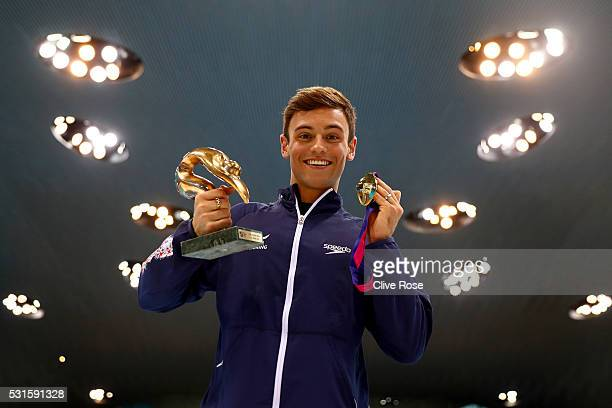 Tom Daley of Great Britain poses with his LEN 'Best Diver' award and gold medal after winning the Men's 10m Platform Final on day seven of the 33rd...
