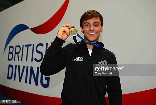 Tom Daley shows off his Gold medal after winning the men's 10m Platform Final during the British Diving Championships 2016 Day Three at Ponds Forge...