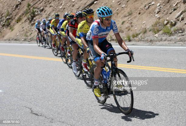 Tom Danielson of the United States riding for Garmin Sharp sets the pace at the front of the yellow jersey group and is followed by Rafal Majka of...