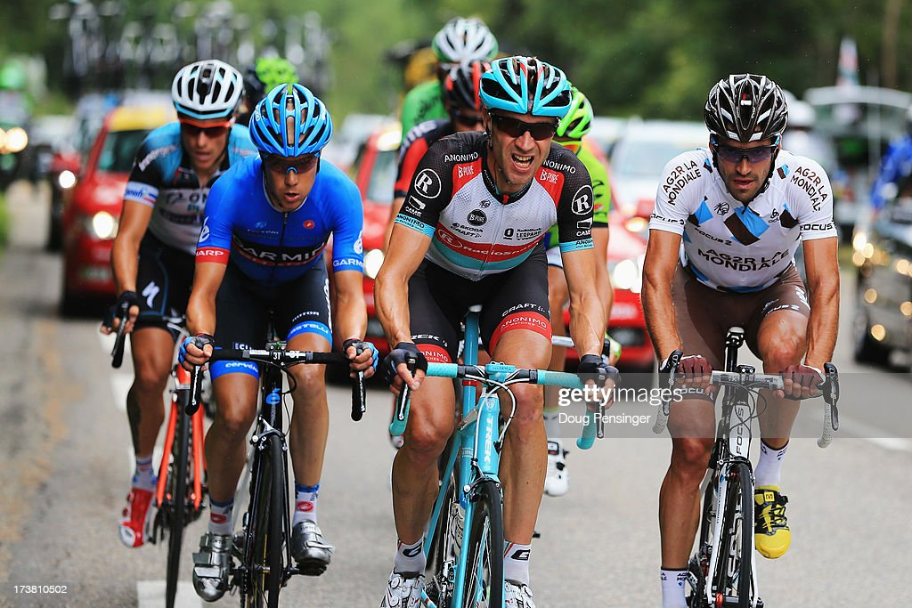 Tom Danielson of the Usa and Team Garmin-Sharp, Jens Voigt of Germany and Team Radioshack Leopard and Christophe Riblon of France and Team AG2R La Mondiale ride at the front of the breakaway group during stage eighteen of the 2013 Tour de France, a 172.5KM road stage from Gap to l'Alpe d'Huez, on July 18, 2013 in Gap, France.