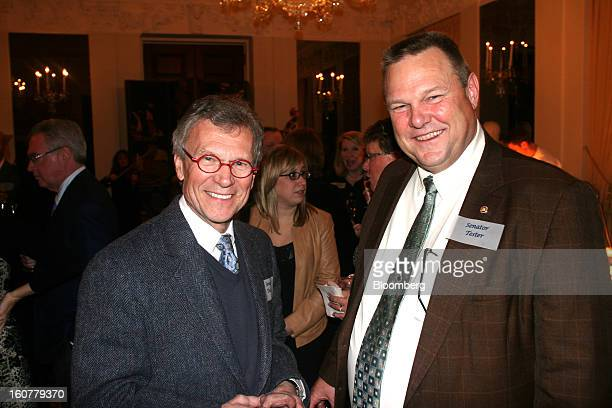 Tom Daschle former Democratic senator of South Dakota and Senator Jon Tester Democrat of Montana pause for a portrait at the residence of British...