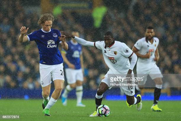 Tom Davies of Everton and Abdoulaye Doucoure of Watford battle for possession during the Premier League match between Everton and Watford at Goodison...