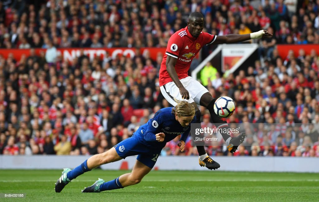 Tom Davies of Everton and Eric Bailly of Manchester United battle for possession during the Premier League match between Manchester United and Everton at Old Trafford on September 17, 2017 in Manchester, England.