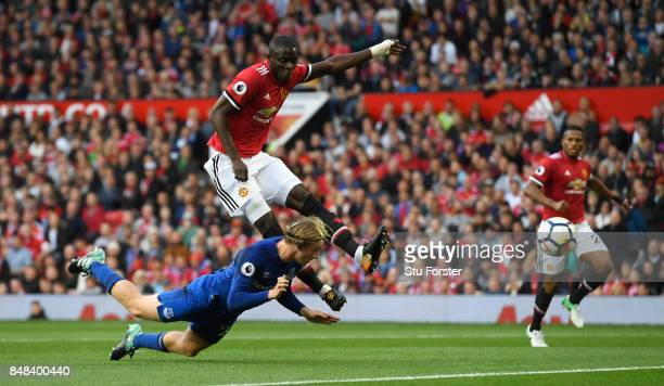 Tom Davies of Everton and Eric Bailly of Manchester United battle for possession during the Premier League match between Manchester United and...