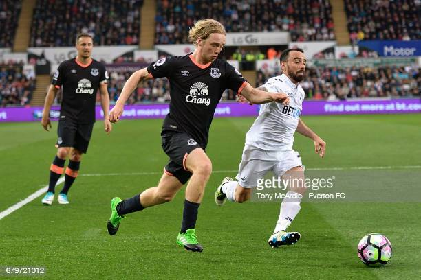 Tom Davies of Everton and Leon Britton of Swansea challenge for the ball during the Premier League match between Swansea City and Everton at the...