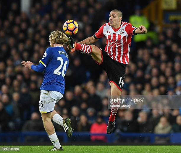 Tom Davies of Everton and Oriol Romeu of Southampton battle for possession during the Premier League match between Everton and Southampton at...