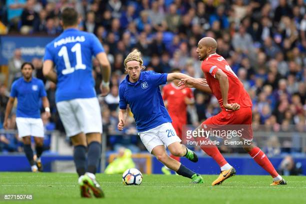 Tom Davies of Everton and Steven N'Zonzi of Sevilla challenge for the ball during the Pre Season Friendly match between Everton and Sevilla at...