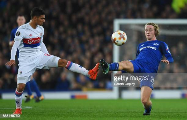 Tom Davies of Everton batles with Houssem Aouar of Lyon during the UEFA Europa League Group E match between Everton FC and Olympique Lyon at Goodison...